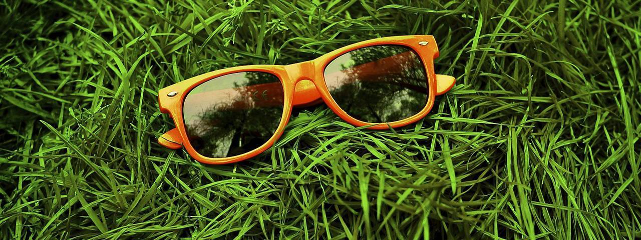 Orange-Sunglasses-in-Grass-1280x480