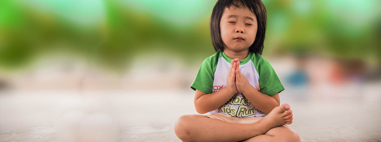 little-girl-yoga-meditates
