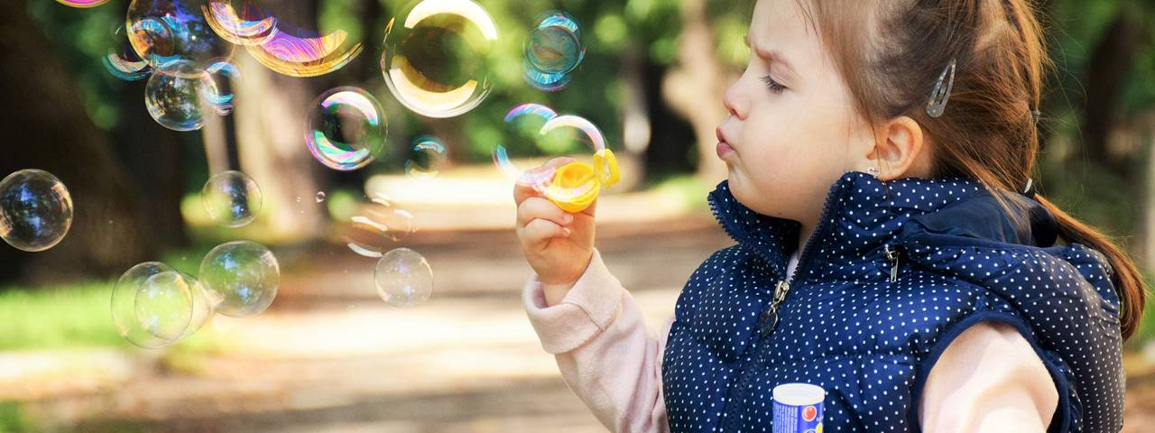Child-Blowing-Bubbles-1280x480